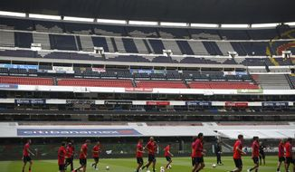 Members of the U.S. national soccer team jog to warm up during a pre-match training session at Azteca Stadium in Mexico City, Saturday, June 10, 2017. The U.S. will face Mexico Sunday in a 2018 Russia World Cup qualifying match. (AP Photo/Rebecca Blackwell)