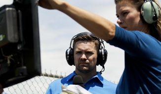 Driver Ricky Stenhouse Jr., left, and broadcast pit reporter Jamie Little look over a monitor during the NASCAR xfinity Series auto race, Saturday, June 10, 2017, in Long Pond, Pa. (AP Photo/Matt Slocum)