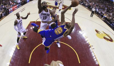 Golden State Warriors forward Kevin Durant (35) shoots past Cleveland Cavaliers center Tristan Thompson (13) during the second half of Game 4 of basketball's NBA Finals in Cleveland, Friday, June 9, 2017. Cleveland won 137-116. (Ronald Martinez/Pool Photo via AP)