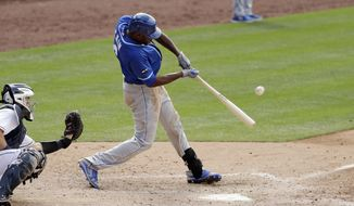 Kansas City Royals' Lorenzo Cain hits a grand slam during the eighth inning of a baseball game against the San Diego Padres, Saturday, June 10, 2017, in San Diego. (AP Photo/Gregory Bull)