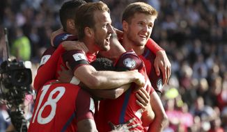 England's Harry Kane, center left, celebrates after scoring his side's second goal during the World Cup Group F qualifying soccer match between Scotland and England at Hampden Park, Glasgow, Scotland, Saturday, June 10, 2017. (AP Photo/Scott Heppell)