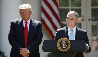 In this June 1, 2017, file photo, President Donald Trump listens as EPA Administrator Scott Pruitt speaks about the U.S. role in the Paris climate change accord in the Rose Garden of the White House in Washington. (AP Photo/Pablo Martinez Monsivais)