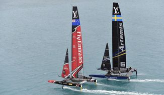 In this photo provided by the America's Cup Event Authority, Emirates Team New Zealand, left, competes against Sweden's Artemis Racing on the second day of the best-of-nine America's Cup challenger finals on Bermuda's Great Sound, Sunday, June 11, 2017. (Ricardo Pinto/America's Cup Event Authority via AP)
