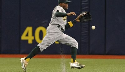 Oakland Athletics center fielder Rajai Davis chases an RBI-single hit by Tampa Bay Rays' Evan Longoria during the fifth inning of a baseball game Sunday, June 11, 2017, in St. Petersburg, Fla. (AP Photo/Steve Nesius)