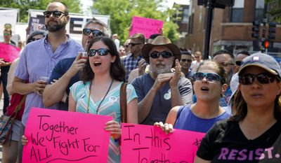 People attend the LGBTQ Chicago Equality rally Sunday, June 11, 2017, during Midsommarfest in the Andersonville neighborhood of Chicago. (Brian Cassella/Chicago Tribune via AP)