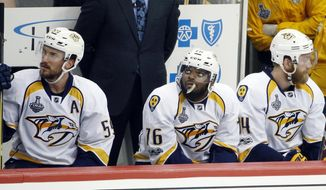 Nashville Predators' Roman Josi, left, P.K. Subban, center, and Mattias Ekholm, right, sit on the bench during the third period in Game 5 of the team's NHL hockey Stanley Cup Final against the Pittsburgh Penguins, Thursday, June 8, 2017, in Pittsburgh. (AP Photo/Gene J. Puskar)