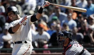 San Francisco Giants' Buster Posey, left, drives in two runs with a double against the Minnesota Twins during the seventh inning of a baseball game, Sunday, June 11, 2017, in San Francisco. (AP Photo/Marcio Jose Sanchez)