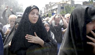 FILE - In this Friday, June 9, 2017 file photo, Iranians attend the funeral of victims of an Islamic State militant attack, in Tehran, Iran. Its strongholds in Iraq and Syria slipping from its grasp, the Islamic State group threatened to make this years Ramadan a bloody one at home and abroad. With attacks in Egypt, Britain and Iran among others and a land-grab in the Philippines, the group is trying to divert attention from its losses and win over supporters around the world in the twisted competition for jihadi recruits. (AP Photo/Ebrahim Noroozi, File)