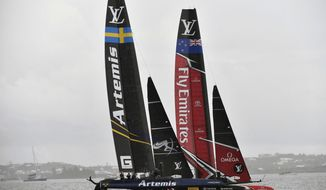 In this photo provided by the America's Cup Event Authority, Emirates Team New Zealand, right, competes against Sweden's Artemis Racing on the third day of the best-of-nine America's Cup challenger finals on Bermuda's Great Sound, Monday, June 12, 2017. (Ricardo Pinto/America's Cup Event Authority via AP)