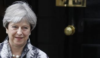 Britain's Prime Minister Theresa May leaves after a cabinet meeting at 10 Downing Street after the general election in London, Monday, June 12, 2017.(AP Photo/Frank Augstein)