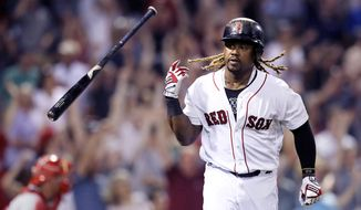 Boston Red Sox designated hitter Hanley Ramirez tosses his bat after his solo home run against the Philadelphia Phillies during the eighth inning of a baseball game at Fenway Park in Boston, Monday, June 12, 2017. (AP Photo/Charles Krupa)
