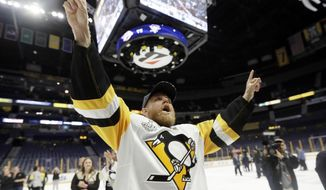 Pittsburgh Penguins' Patric Hornqvist (72), of Sweden, celebrates as he leaves the ice after defeating the Nashville Predators 2-0 in Game 6 of the NHL hockey Stanley Cup Final, Monday, June 12, 2017, in Nashville, Tenn. (AP Photo/Mark Humphrey)