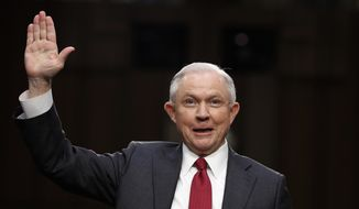 Attorney General Jeff Sessions is sworn-in on Capitol Hill in Washington, Tuesday, June 13, 2017, prior to testifying before the Senate Intelligence Committee hearing about his role in the firing of James Comey, his Russian contacts during the campaign and his decision to recuse from an investigation into possible ties between Moscow and associates of President Donald Trump. (AP Photo/Alex Brandon)