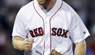 Boston Red Sox relief pitcher Blaine Boyer lets out a yell after striking out Philadelphia Phillies' Freddy Galvis, with the bases loaded, to end the top of the eighth inning of a baseball game at Fenway Park in Boston, Tuesday, June 13, 2017. (AP Photo/Charles Krupa)