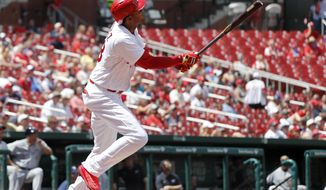 St. Louis Cardinals' Jose Martinez watches his solo home run during the fifth inning in the first baseball game of a doubleheader against the Milwaukee Brewers, Tuesday, June 13, 2017, in St. Louis. (AP Photo/Jeff Roberson)