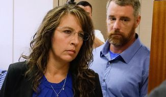 Harris County Sheriff's deputy Chauna Thompson and her husband, Terry Thompson, arrive at court, Tuesday, June 13, 2017 in Houston, Texas. The couple were indicted on murder charges in the death of John Hernandez who died in the hospital on May 31 following the May 28 confrontation with the couple outside a Denny's restaurant. A medical examiner ruled that he died of lack of oxygen to the brain caused by strangulation and chest compression.( Melissa Phillip/Houston Chronicle via AP)