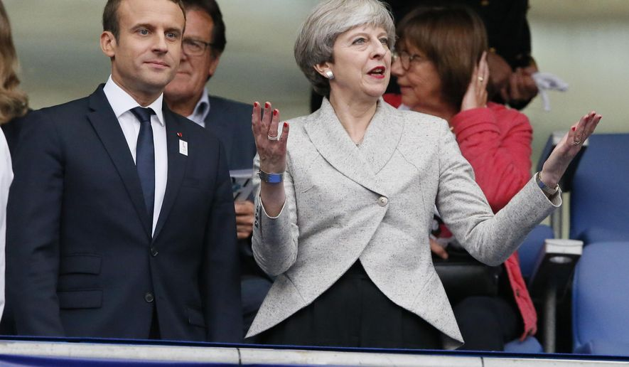 French President Emmanuel Macron and Britain's Prime Minister Theresa May arrive to attend a friendly soccer match between France and England at the Stade de France in Saint Denis, north of Paris, France, Tuesday, June 13, 2017. After their talks at the Elysee Palace, the two leaders watch a France-England football match that will honor victims of extremist attacks in both countries. (AP Photo/Francois Mori