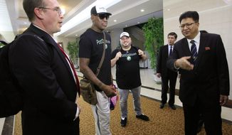 Former NBA basketball star Dennis Rodman, center,  is greeted by North Korea's Sports Ministry Vice Minister Son Kwang Ho, right, upon his arrival at Sunan International Airport on Tuesday, June 13, 2017, in Pyongyang, North Korea.  Rodman has arrived in North Korea on his first visit since President Donald Trump took office. (AP Photo/Kim Kwang Hyon)