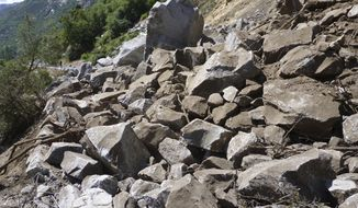 This Monday, June 12, 2017, photo provided by the National Park Service shows a rockslide that blocked one of the main roads into Yosemite National Park in California. About 4,000 tons (3,600 metric tons) of rock detached from a cliff on Monday, blocking El Portal Road, Park spokesman Scott Gediman. (NPS Photo via AP)