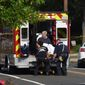 Rep. Roger Williams, R-Texas is placed into an ambulance at the scene of a shooting at a baseball field in Alexandria, Va., Wednesday, June 14, 2017. Members of Congress were practicing for a game when a gunman started shooting. (AP Photo/Kevin S. Vineys) (credit)
