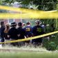 Investigators confer before searching for evidence in Alexandria, Virginia, after a shooting during Congressional baseball practice. (Associated Press)