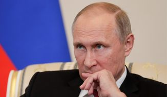 Russian President Vladimir Putin was denounced for aggressions including the annexation of Crimea, intervention in the Syrian civil war, meddling in Ukraine and threatening NATO countries. (Associated Press) ** FILE **