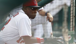 Washington Nationals manager Dusty Baker watches from the dugout during the seventh inning of the team's baseball game against the Atlanta Braves at Nationals Park, Wednesday, June 14, 2017, in Washington. The Braves won 13-2. (AP Photo/Carolyn Kaster)