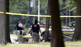 FBI investigators work the scene of a shooting near at a baseball field in Alexandria, Va., Wednesday, June 14, 2017, where House Majority Whip Steve Scalise of La., and others were shot during a congressional baseball practice. (AP Photo/Alex Brandon)