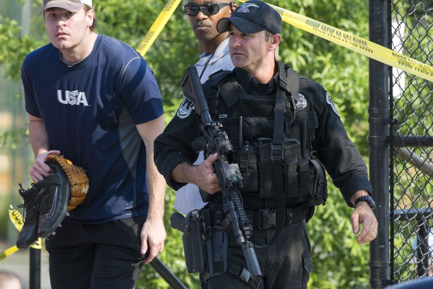 A member of the Congressional Republican softball team is allowed to leave the scene of a multiple shooting involving House Majority Whip Steve Scalise of La., Wednesday, June 14, 2017, in Alexandria, Va. (AP Photo/Cliff Owen)