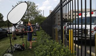 Television crews line the emergency entrance at MedStar Washington Hospital Center in Washington, Wednesday, June 14, 2017, where House Majority Whip Steve Scalise of La. was taken after being shot in Alexandria, Va., during a Congressional baseball practice. (AP Photo/Jacquelyn Martin)
