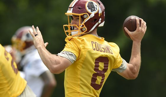 Washington Redskins quarterback Kirk Cousins (8) looks to pass during NFL football practice, Wednesday, June 14, 2017, in Ashburn, Va. (AP Photo/Nick Wass)