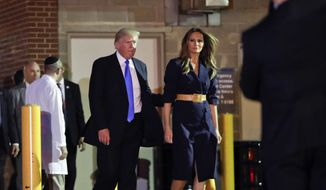 President Donald Trump and first lady Melania Trump walk to their vehicle after visiting MedStar Washington Hospital Center in Washington, Wednesday, June 14, 2017, where House Majority Leader Steve Scalise of La. was taken after being shot in Alexandria, Va., during a Congressional baseball practice. (AP Photo/Pablo Martinez Monsivais)