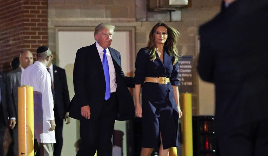 President Donald Trump And First Lady Melania Trump Walk