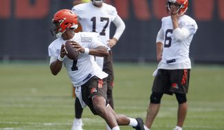 FILE - In this Tuesday, June 13, 2017, file photo, Cleveland Browns' DeShone Kizer (7) looks to throw as Brock Osweiler (17) and Cody Kessler (6) look on during NFL football practice at the team's training facility in Berea, Ohio. There's a perceived pecking order at starting quarterback for the Browns. It's Cleveland, the lineup will change. Cody Kessler appears to be the front-runner to start, but veteran Brock Osweiler and rookie DeShone Kizer have made strides in a competition that will only heat up in training camp next month. (AP Photo/Ron Schwane)