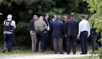 Law enforcement talk while investigating outside the home of James T. Hodgkinson on Wednesday, June 14, 2017, in Belleville, Ill. Officials said Hodgkinson has been identified as the man who opened fire on Republican lawmakers at a congressional baseball practice Wednesday morning in Alexandria, Va. (AP Photo/Jeff Roberson)
