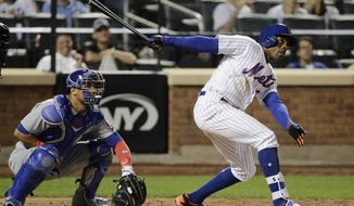 New York Mets' Curtis Granderson and Chicago Cubs catcher Miguel Montero watch Granderson's 300th career home run, during the eighth inning of a baseball game Wednesday, June 14, 2017, in New York. The Mets won 9-4. (AP Photo/Frank Franklin II)