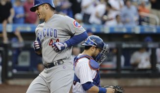 Chicago Cubs' Anthony Rizzo (44) runs past New York Mets catcher Travis d'Arnaud after hitting a home run during the first inning of a baseball game Wednesday, June 14, 2017, in New York. (AP Photo/Frank Franklin II)