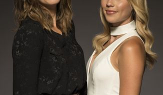 """In this June 2, 2017 photo, Mandy Moore, left, and Claire Holt pose for a portrait at the """"47 Meters Down"""" junket at the Montage Hotel in Beverly Hills, Calif. (Photo by Ron Eshel/Invision/AP)"""