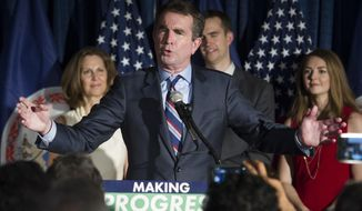 Virginia Democratic candidate for governor, Lt. Gov. Ralph Northam, with his wife Pam, left, son Weston, and daughter Aubrey celebrate his victory in the Democratic primary during an election party in Crystal City, Va., Tuesday, June 13, 2017. Northam faced former congressman Tom Perriello in Tuesday's primary. (AP Photo/Cliff Owen)