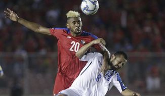 Panama's Anibal Godoy, left, and Honduras' Alfredo Mejia fight for the ball during a 2018 Russia World Cup qualifying soccer match at Rommel Fernandez Stadium in Panama City, Tuesday, June 13, 2017. (AP Photo/Arnulfo Franco)