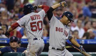 Boston Red Sox's Mookie Betts (50) celebrates with Xander Bogaerts after Betts hit a solo home run off Philadelphia Phillies' Jeremy Hellickson during the fourth inning of a baseball game, Wednesday, June 14, 2017, in Philadelphia. (AP Photo/Derik Hamilton)