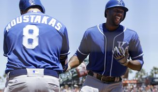 Kansas City Royals' Lorenzo Cain, right, celebrates after hitting a solo home run against the San Francisco Giants with Mike Moustakas during the third inning of a baseball game in San Francisco, Wednesday, June 14, 2017. (AP Photo/Jeff Chiu)