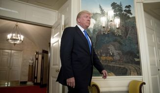 President Donald Trump arrives in the Diplomatic Room of the White House in Washington, Wednesday, June 14, 2017, to talk about the shooting in Alexandria, Va. where House Majority Whip Steve Scalise of La., and others, where shot during a Congressional baseball practice. (AP Photo/Andrew Harnik)