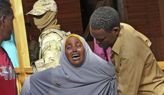"A mother whose daughter was shot in the head by attackers during a militant attack on a restaurant, grieves in Mogadishu, Somalia Thursday, June 15, 2017. Somalia's security forces early Thursday morning ended a night-long siege by al-Shabab Islamic extremists at the popular ""Pizza House"" restaurant in the capital. (AP Photo/Farah Abdi Warsameh)"