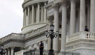 Capitol Hill Police officers scan the area on Capitol Hill in Washington, Wednesday, June 14, 2017, after House Majority Whip Steve Scalise of La. was shot during during a congressional baseball practice in Alexandria Va. (AP Photo/Jose Luis Magana)