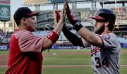 Washington Nationals' Bryce Harper (34) is congratulated by Jose Lobaton (59) after hitting a solo home run against the New York Mets during the first inning of a baseball game Thursday, June 15, 2017, in New York. (AP Photo/Julie Jacobson)