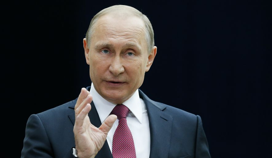 Russian President Vladimir Putin gestures while speaking to the media after his annual televised call-in show in Moscow, Russia, Thursday, June 15, 2017. Putin has his annual live call-in show, a TV marathon lasting for hours in which he may for the first time declare his intention to seek another term in 2018, comment on the latest opposition protest and talk about Russia-U.S. ties and other issues. (AP Photo/Alexander Zemlianichenko) ** FILE **