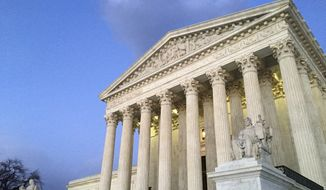People stand on the steps of the Supreme Court at sunset in Washington, Feb. 13, 2016. (AP Photo/Jon Elswick) ** FILE **