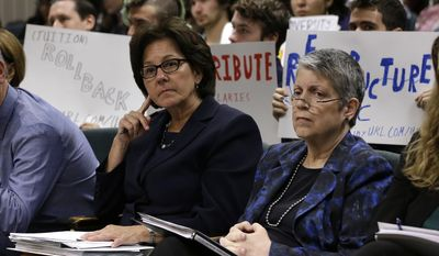 FILE - In this Tuesday, May 2, 2017 file photo, Monica Lozano, left, chair of the University of California Board of Regents, and UC President Janet Napolitano, sit in the audience before appearing before the Joint Legislative Audit Committee in Sacramento, Calif. Lawmakers are expected to vote Thursday, June 15. 2017, on a state budget plan that withholds $50 million from the UC system until Napolitano's office shows it's complying with recommendations from a scathing audit of her office. (AP Photo/Rich Pedroncelli, File)