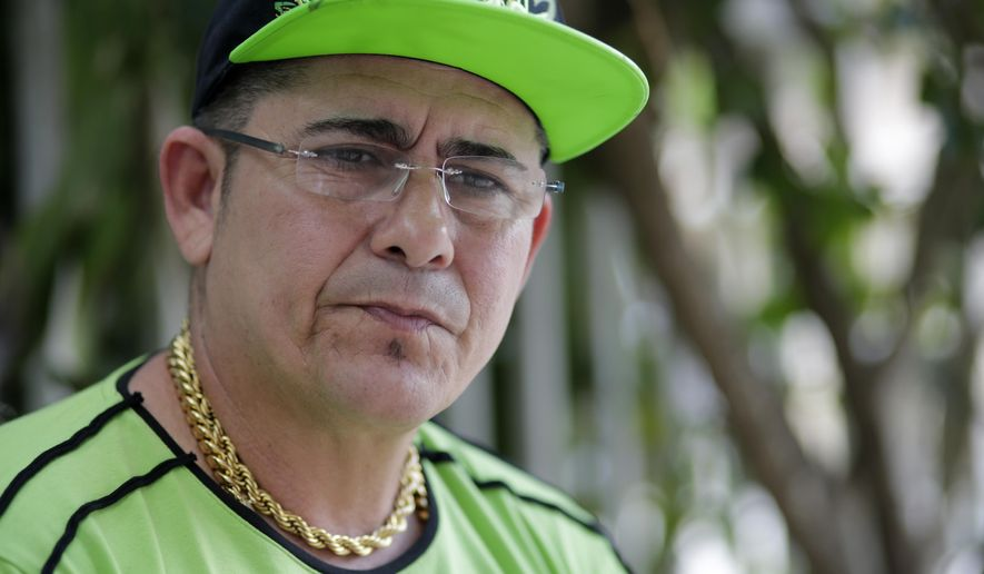 In this May 17, 2017 photo, Cuban immigrant Hermes Vigoa, who arrived in the U.S. two years before Obama canceled the fast-track citizenship system, gives an interview outside his home in Miami, Florida. Vigoa, 46, was detained when he showed up at an immigration office in Miami earlier this year to renew a temporary document while he completed the permanent-residency process. Tens of thousands of Cubans living in the U.S. are adapting to a new reality: After enjoying decades of favored status dating back to the Cold War, many of them now face the same deportation risks as any other immigrants. (AP Photo/Lynne Sladky)